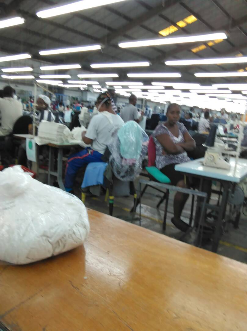 Workers stop sewing at Pacific Sport factory.