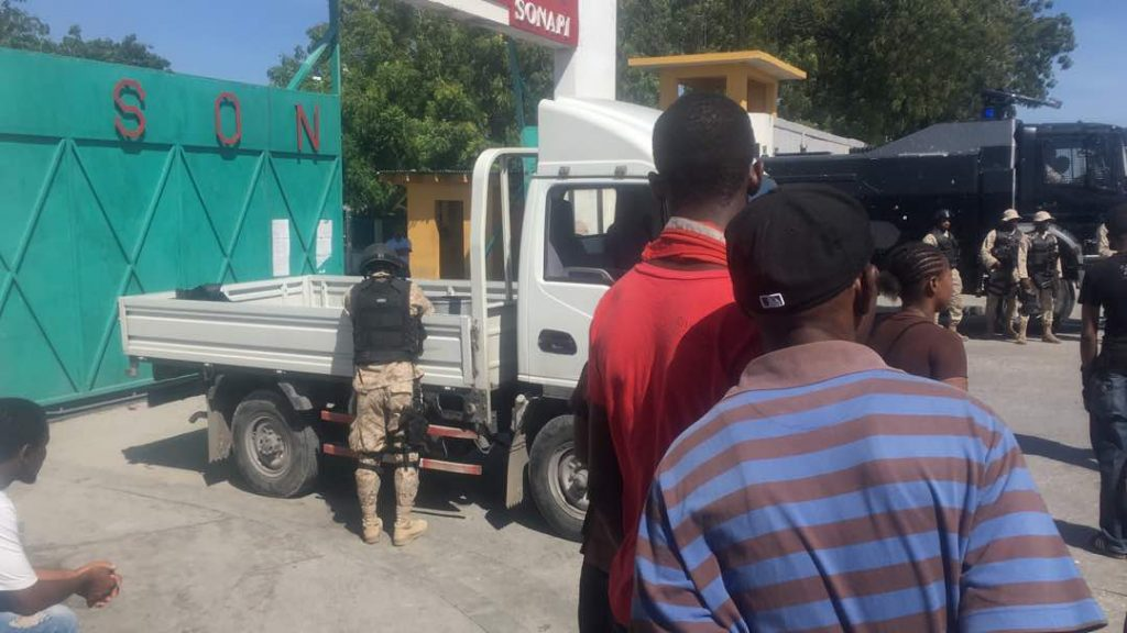 Mon 07.31.17 - Port Au Prince - Police block the entrance of Sonapi Industrial Park.